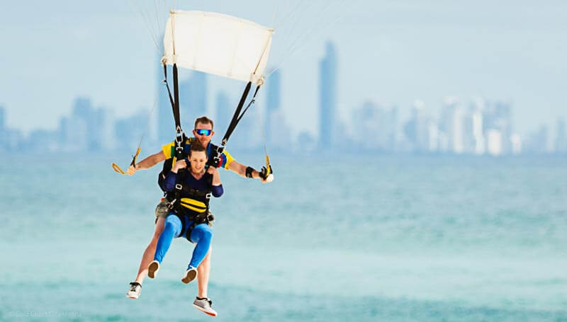 An unforgettable parasailing experience with Surfers Paradise skyline as a backdrop